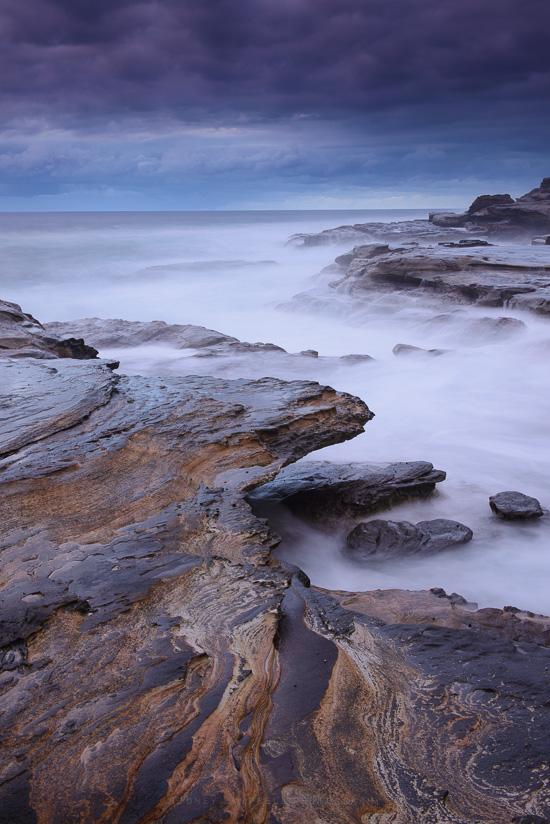 Thin Film Reflection on Rocks